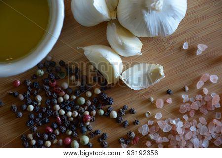 oil, garlic, salt, and pepper