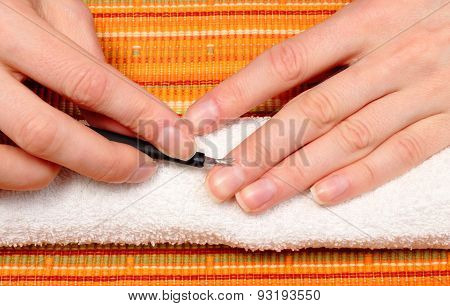 Woman Trimming Cuticles Of Hand, Manicure