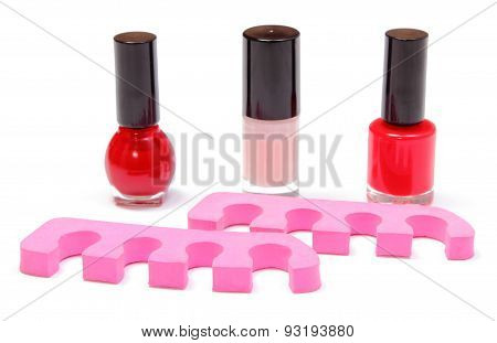 Nail Polishes And Accessories On White Background