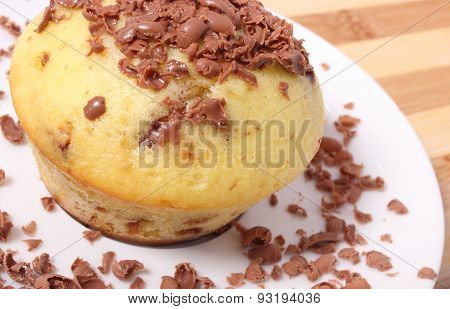 Fresh Baked Muffins And Grated Chocolate On White Plate