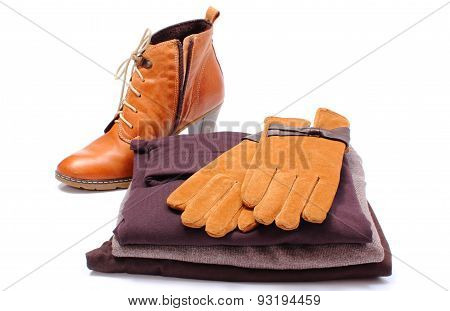 Womanly Leather Shoes, Gloves And Clothes On White Background