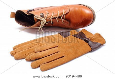 Womanly Leather Shoes And Gloves On White Background