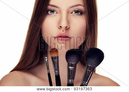 Beautiful Girl With Perfect Skin And Make Up Brushes