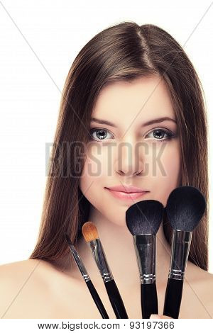Girl Smiling With Set Of Brushes Isolated Over White Background