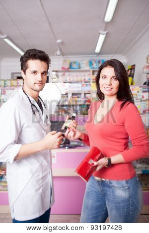 Customer And Doctor In Drugstore