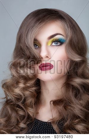 Fashion Make Up On Girl Over Grey Background