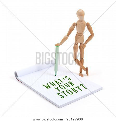 Wooden Mannequin Writing In Scrapbook - What's Your Story