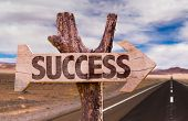 foto of prosperity sign  - Success direction sign with road background - JPG