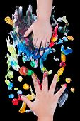 pic of finger-painting  - Closeup of little children hands doing finger painting with various colors on black background art education and creativity concept top view - JPG