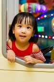 foto of bus driver  - Little Asain Chinese Bus Driver at indoor playground - JPG