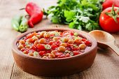 stock photo of chickpea  - cooked chickpeas with tomatoes in a bowl - JPG