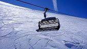 picture of tit  - empty ski cable car at snow mountains Titlis Engelberg Switzerland Horizontal view - JPG