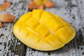picture of mango  - exotic mango and mango milkshake on wooden background - JPG