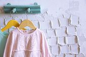 picture of habilis  - Child dress on hanger on white wall background - JPG