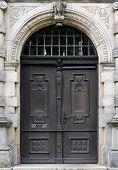 stock photo of wooden door  - Old wooden door with ornaments - JPG