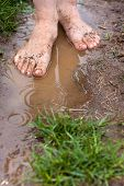 image of barefoot  - feet of a young woman walking barefoot through the puddles - JPG