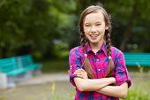 image of teenagers  - Beautiful smiling teenage girl in a summer park - JPG