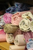 stock photo of quilt  - Small rolls of colorful fabric for a quilt - JPG