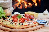pic of hot fresh pizza  - fresh baked tasty pizza near wood oven - JPG