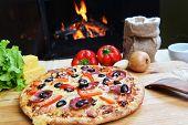 stock photo of hot fresh pizza  - fresh baked tasty pizza near wood oven  - JPG