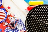 stock photo of barbie  - Table set with white blue and red decorations for July 4th barbecue. ** Note: Soft Focus at 100%, best at smaller sizes - JPG