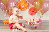 stock photo of fancy cake  - Happy Fancy Beautiful cute baby girl celebrates birthday one year - JPG