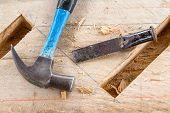 stock photo of chisel  - workshop of gouge wood chisel carpenter tool hammer on hardwood - JPG