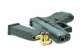 image of pistols  - 9mm bullets and black gun pistol isolated on white background - JPG