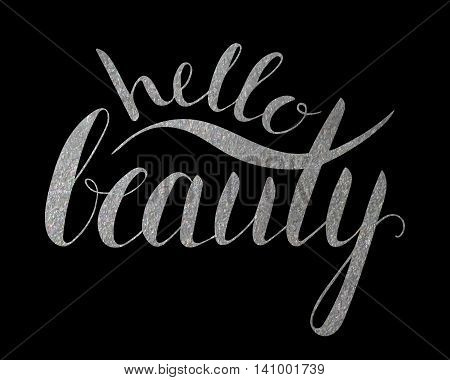 Handwritten calligraphic silver textured inscription Hello beauty on black background.