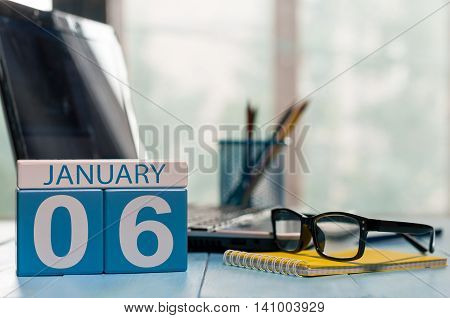 January 6th. Day 6 of month, calendar on accauntant workplace background. Winter time. Empty space for text.