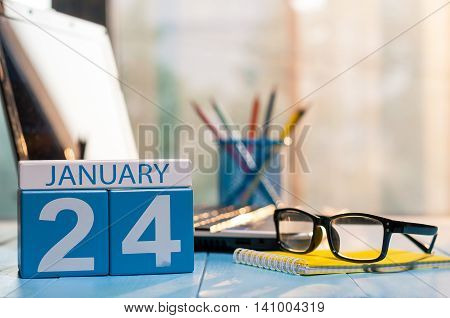 January 24th. Day 24 of month, calendar on manager workplace background. Winter concept. Empty space for text.
