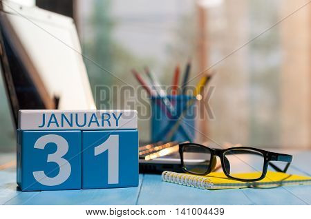 January 31st. Day 31 of month, calendar on workplace background. Winter at work concept. Empty space for text.