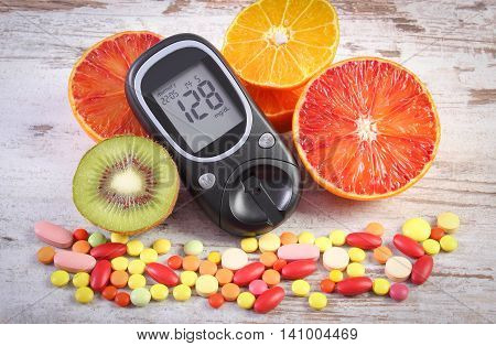 Glucose Meter With Result, Fruits And Colorful Medical Pills, Diabetes, Healthy Lifestyle And Nutrit