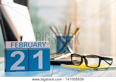 February 21st. Day 21 of month, calendar on teacher table background. Winter time. Empty space for text.