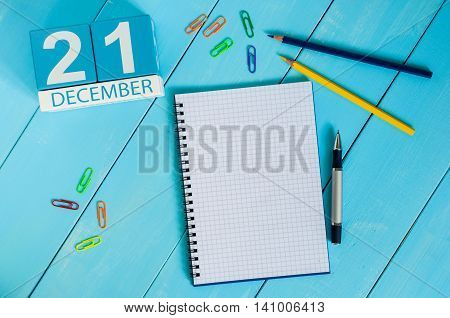 December 21st. Day 21 of month, calendar on teacher table background. Winter time. Empty space for text.