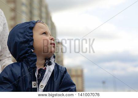 Toddler On Building Background