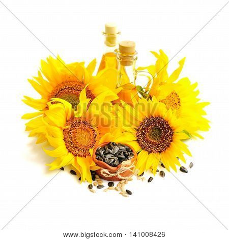 A Small Bowl Of Sunflower Seeds, And Flowers Of Sunflower With Bottle Of Oil  On A White Background