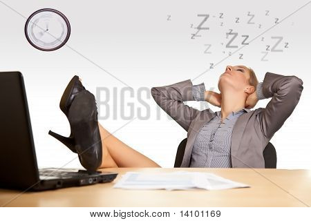 Businesswoman bored in office isolated on white