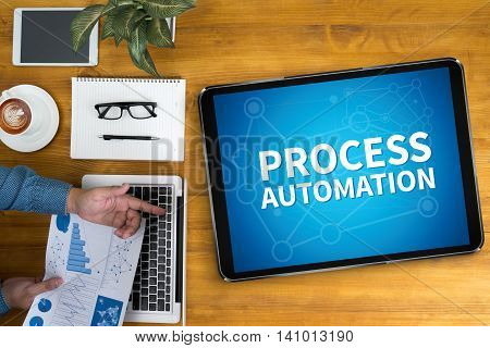 PROCESS AUTOMATION man and hand computer top