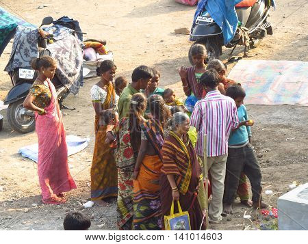 Pune, India - October 31, 2013: A family of poor people in India