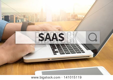 SAAS SEARCH WEBSITE INTERNET SEARCHING man use computer