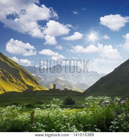 Mountain landscape with church on the hill. Morning in a mountain valley. Ushguli village, Zemo Svaneti, Georgia. Mountain Shkhara main Caucasian ridge