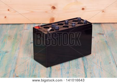 Open Sealed battery on wwood background Seletive focus