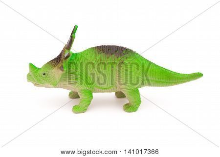side view green styracosaurus toy on a white background