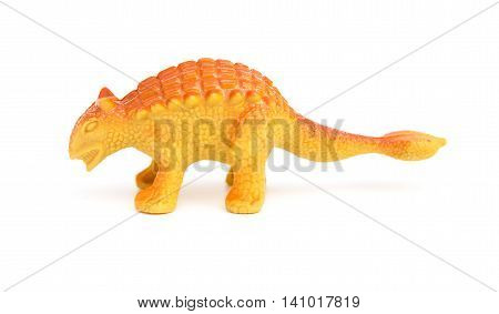 side view orange Pinacosaurus toy on a white background