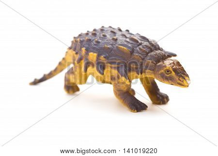 brown plastic dinosaur toy on a white background