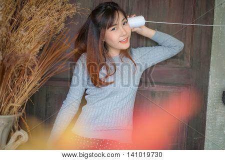 The Cute Girl Talking Through A Tin Phone.