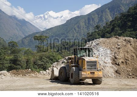 Bhulbhule, Nepal - October 23: A wheel loader on the hydropower plant construction site in the Annapurna Region