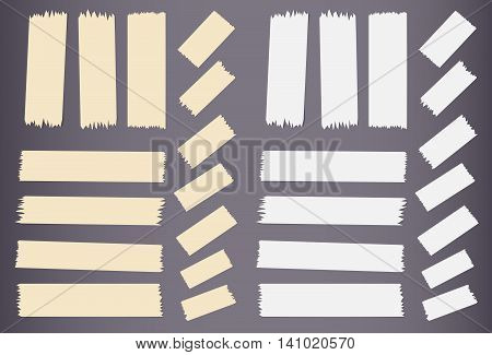 Pieces of different size sticky, adhesive masking tape are on dark gray background.