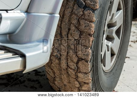 Wheels closeup in dry mud off-road, 4x4